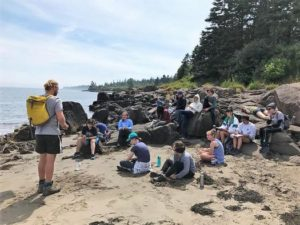 The Whale Camp attendees listen intently