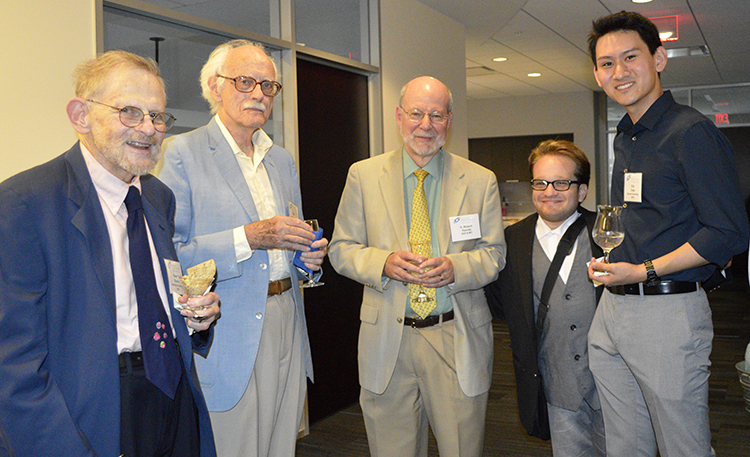 Society Chairman of the Board, H. Robert Horvitz (center), with STS Alumni at the reception.