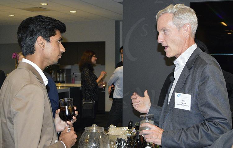 Akamai CEO and event host Tom Leighton (right) talks to STS 2015 alumnus Eswar Anandapadmanaban