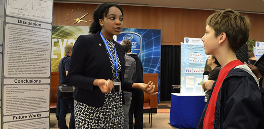 Augusta Uwamanzu-Nna explains her project at STS 2016 public exhibition of projects.