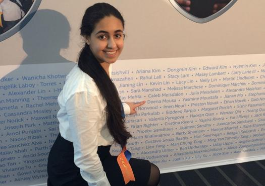Deena points to her name at Intel ISEF 2013. Photo courtesy of Deena Mousa.