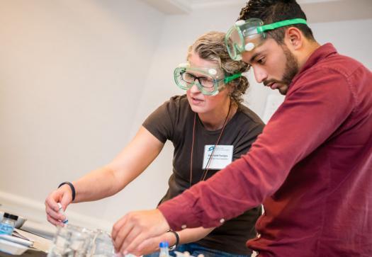 Ellen Smith Tourigny and Elias Arellano Villanueva work on a project at the Advocate Training Institute in Washington, D.C.