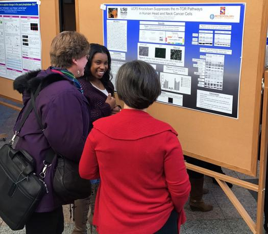 Kearra explains her project to the public at her science fair.
