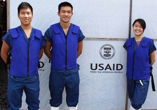 Kevin Tyan (left) and his cofounders, Katherine Jin and Jason Kang, won the USAID Fighting Ebola Grand Challenge and tested Highlight in the field in Liberia.