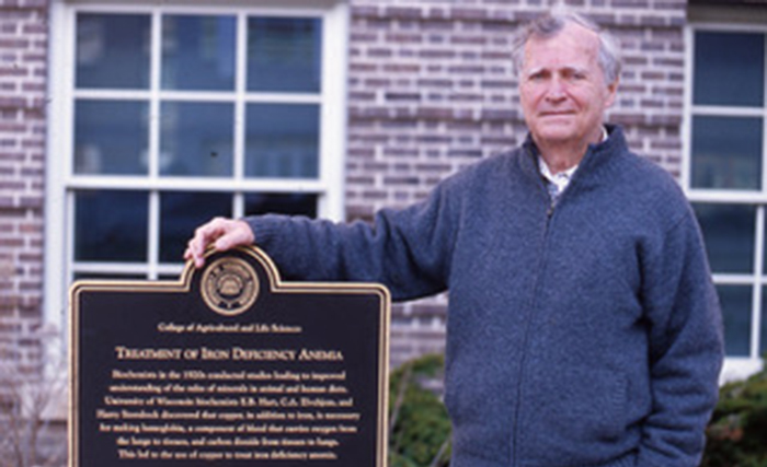 Leslie Klevay in 2013 at a commemorative plaque, where the connection between copper and nutritional health was discovered, at the University of Wisconsin-Madison, where he received the Medical Alumni Citation from the alumni association.