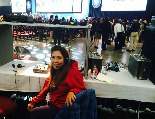 Leticia Aceret is a simultaneous interpreter at Intel ISEF.