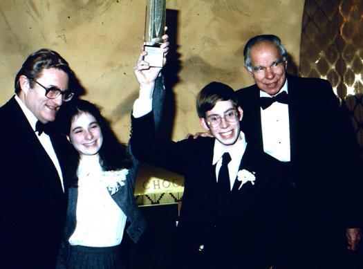 E.G. Sherburne of Science Service, second place winner Lisa Randall, first place winner John Andersland, and Nobel Laureate Glenn Seaborg at Intel STS 1980.