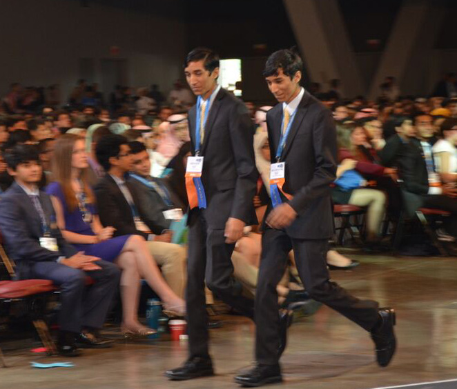 The Dholakia brothers walking up to receive their $3,000 First Award in Physics at Intel ISEF 2015.