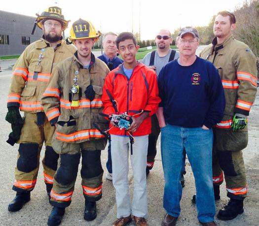 Mihir tested his drone with local firemen to see how it worked in a real-world scenario. Photo courtesy of Mihir Garimella.