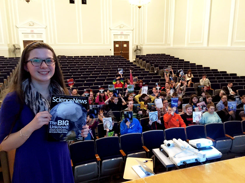 Olivia Sheppard distributed copies of Science News to middle school students when she discussed the endless possibilities that STEM offers.