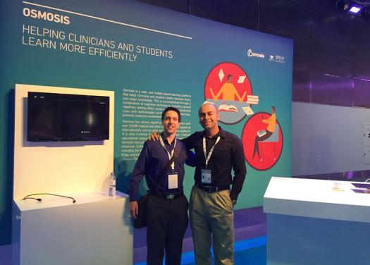 Ryan and Shiv in front of the Osmosis presentation at the World Innovation Summit.