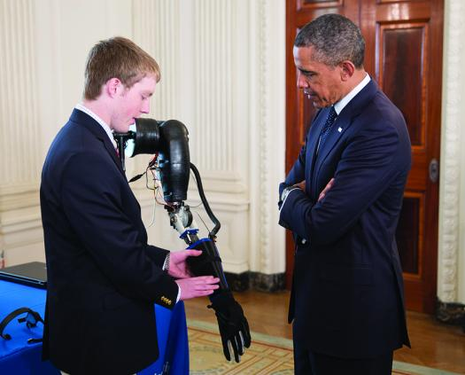 Then President Barack Obama learned about Easton's prosthetic robotic arm at the 2013 White House Science Fair.