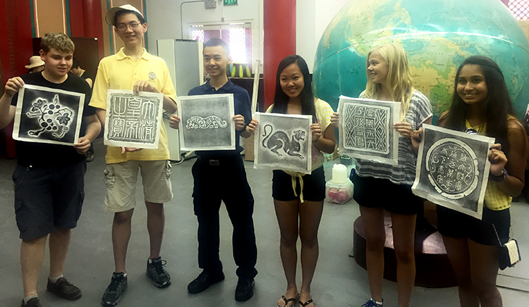 ISEF winners display their Chinese carvings. Photo courtesy of Diya Mathur.
