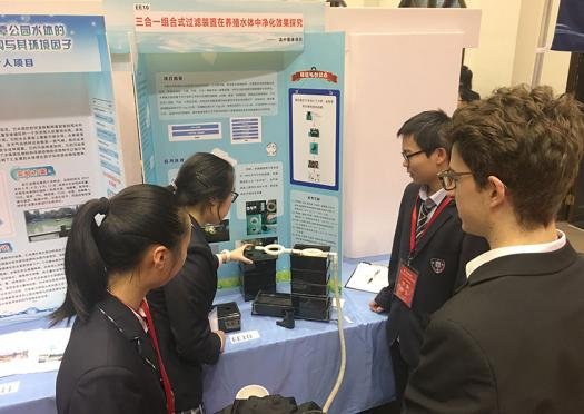 Tassilo viewed projects by Chinese high school students during his trip to China.