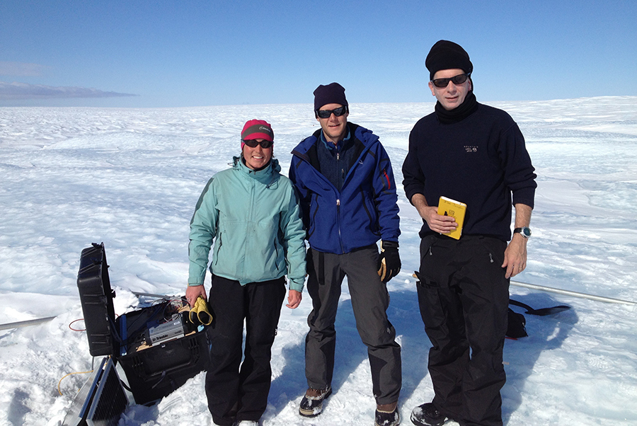 Twila Moon (left) (U. Colorado), Mark Behn (WHOI), and Ian Joughin (U. Washington) in the field checking science instruments near the west coast of the Greenland Ice Sheet.