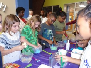 Participants of Marie's Kids STEAM Night making slime