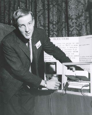 Robert Sproull explains his project at the 1964 Westinghouse STS.