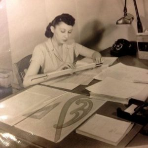 Carol Bauer in 1947 at Hydrocarbon Research, using a slide rule and drafting tools.