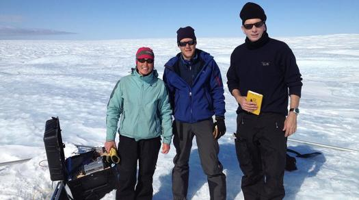 Twila Moon (left) in the field checking science instruments near the west coast of the Greenland Ice Sheet.