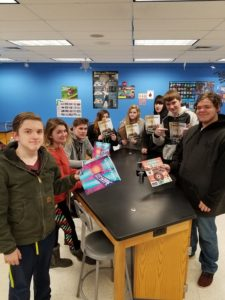 students with SN magazines