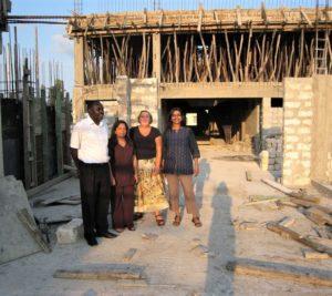 Sumathi (far right) with her team in Kenya in front of the clinic designed by Simon/ Photo courtesy of Sumathi Sivapalasingam