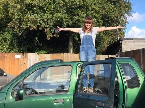 Ruth on her car/for Work from Home