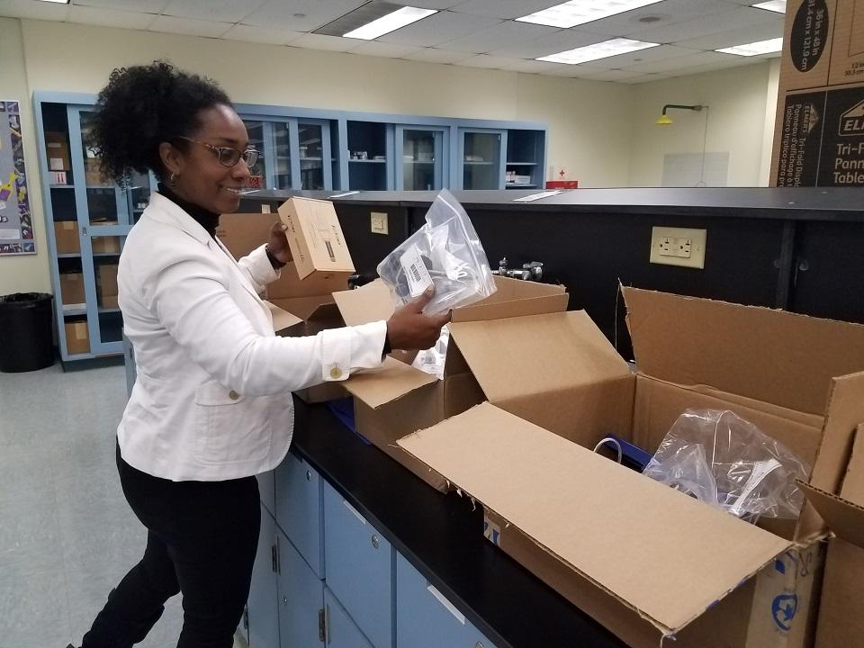 STEM Research Grant teacher unboxing equipment