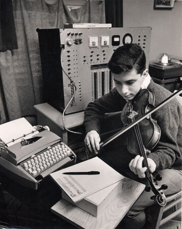 A young Ray Kurzweil plays a composition on the violin written by his music composing program for the Science Talent Search.