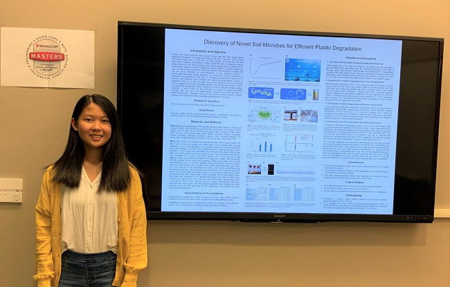 Broadcom MASTERS 2020 finalist Angela Zhan in front of her project displayed on a screen