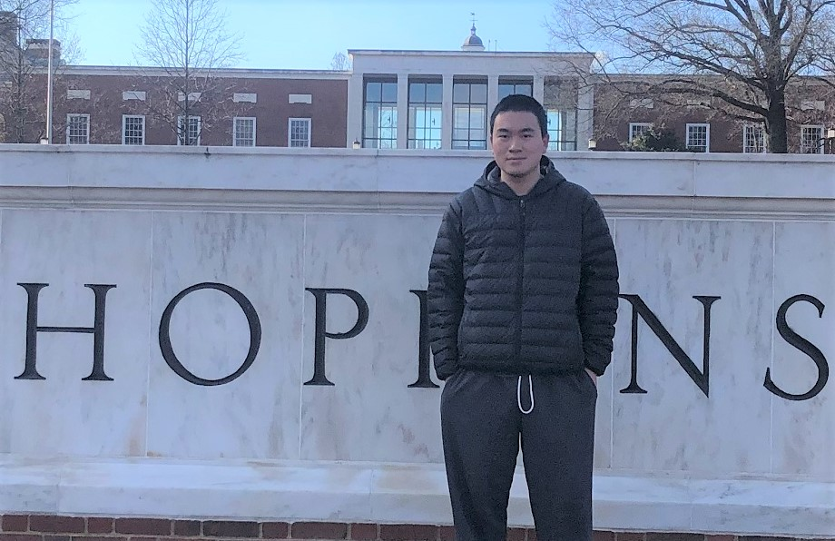alum Nathan Wang pictured in front of JHU