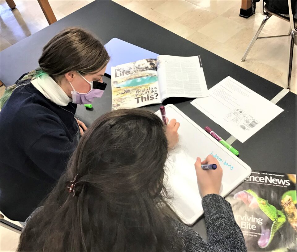Shows a teacher using SNHS resources in the classroom during the pandemic
