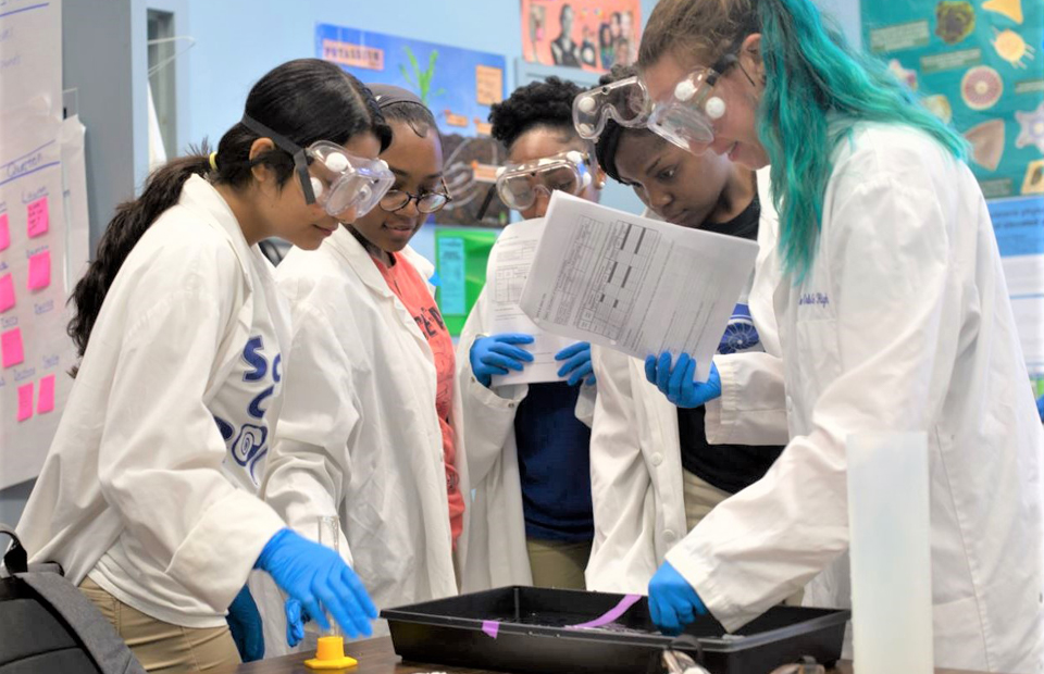 Students at The New Orleans Charter Science and Mathematics High School participate in a science experiment.